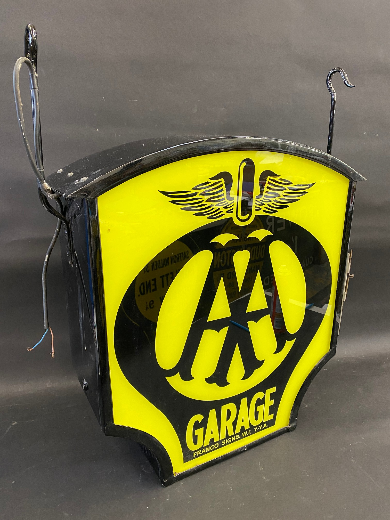 """A decorative dome-topped hanging lightbox bearing AA garage emblem to both sides, 23 1/2"""" wide x 24"""""""