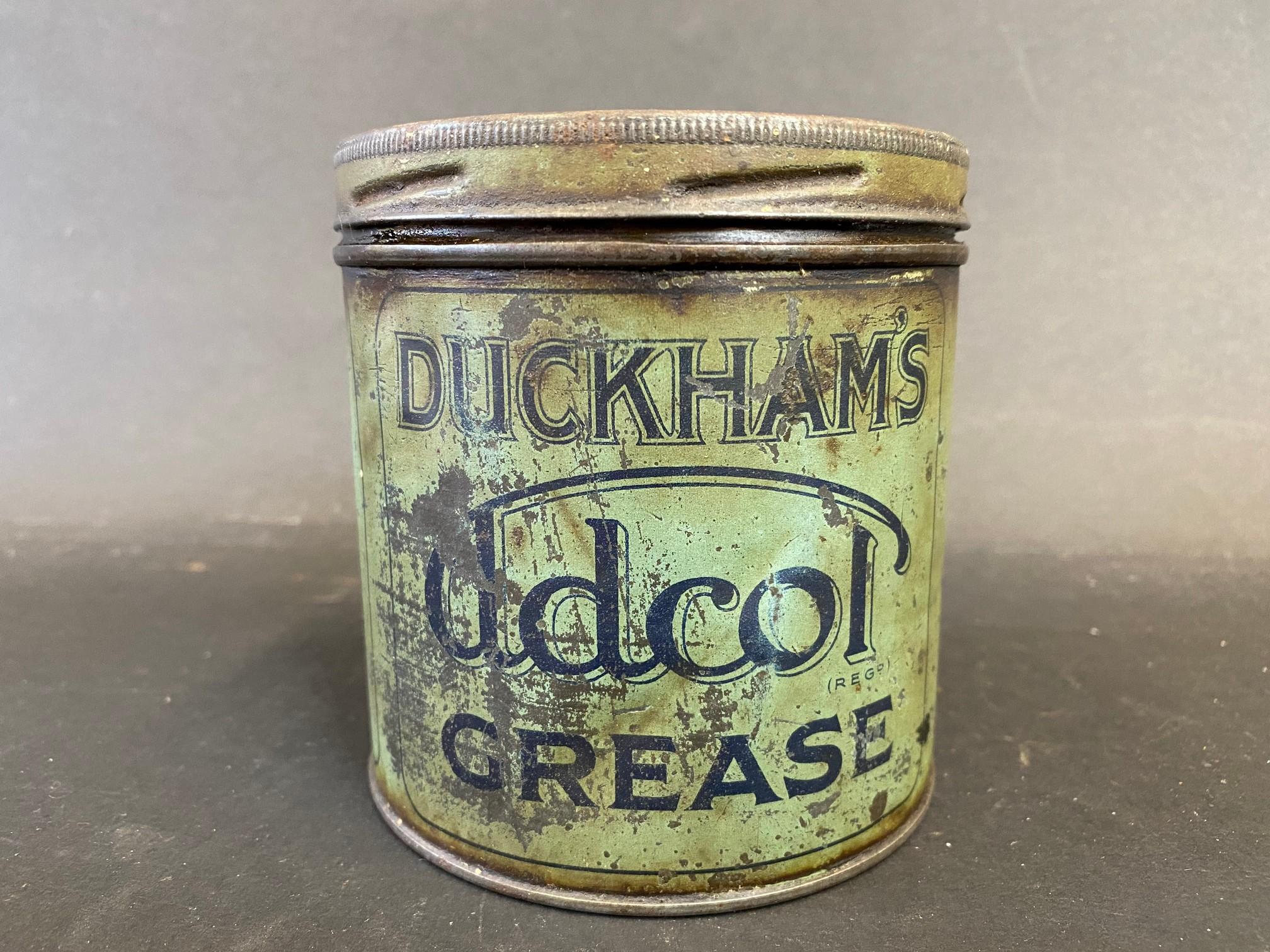 A Duckham's Adcol grease tin.