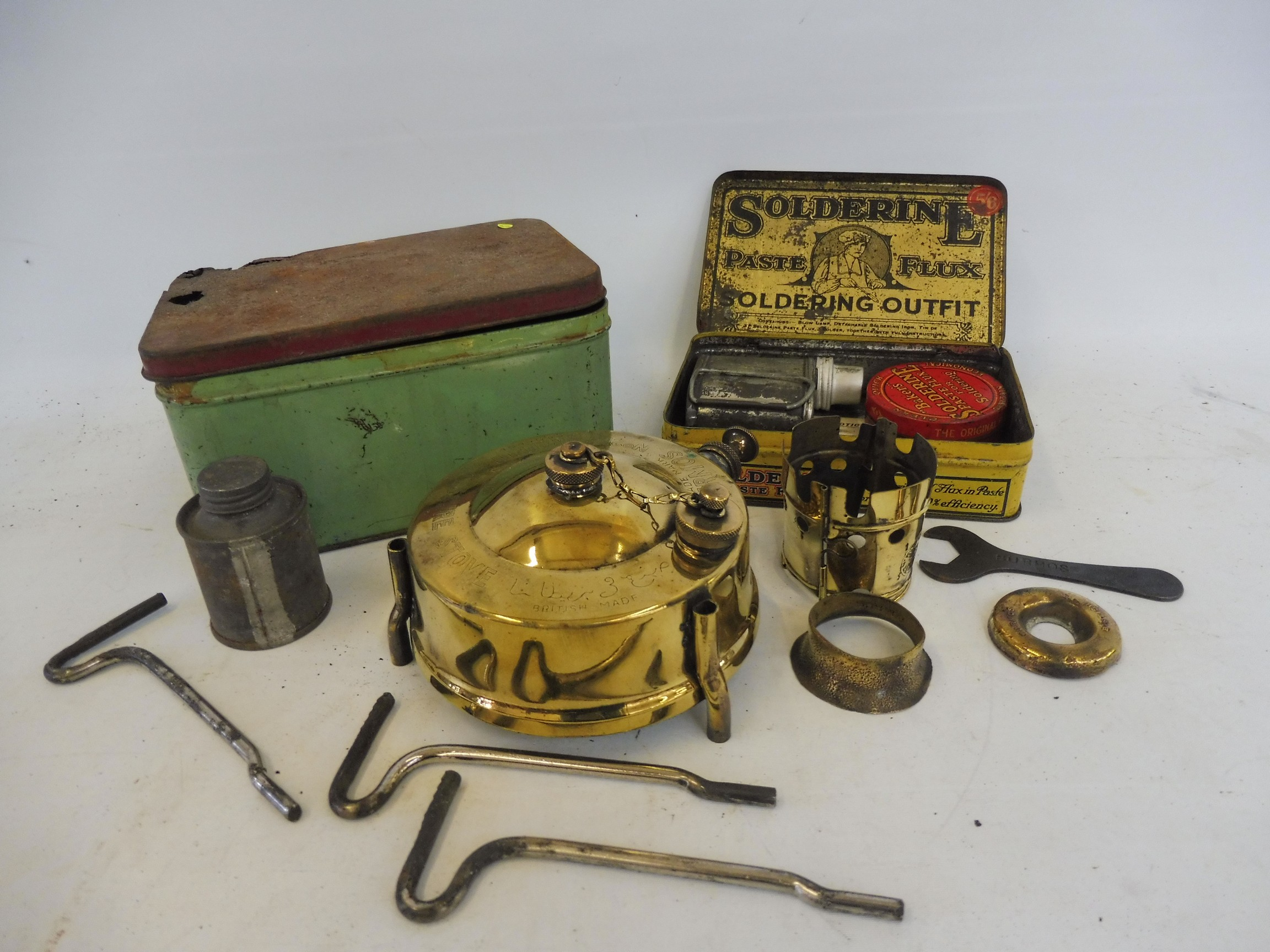 A Burmos polished brass No. 21 paraffin pressure stove outfit and a soldering outfit in original