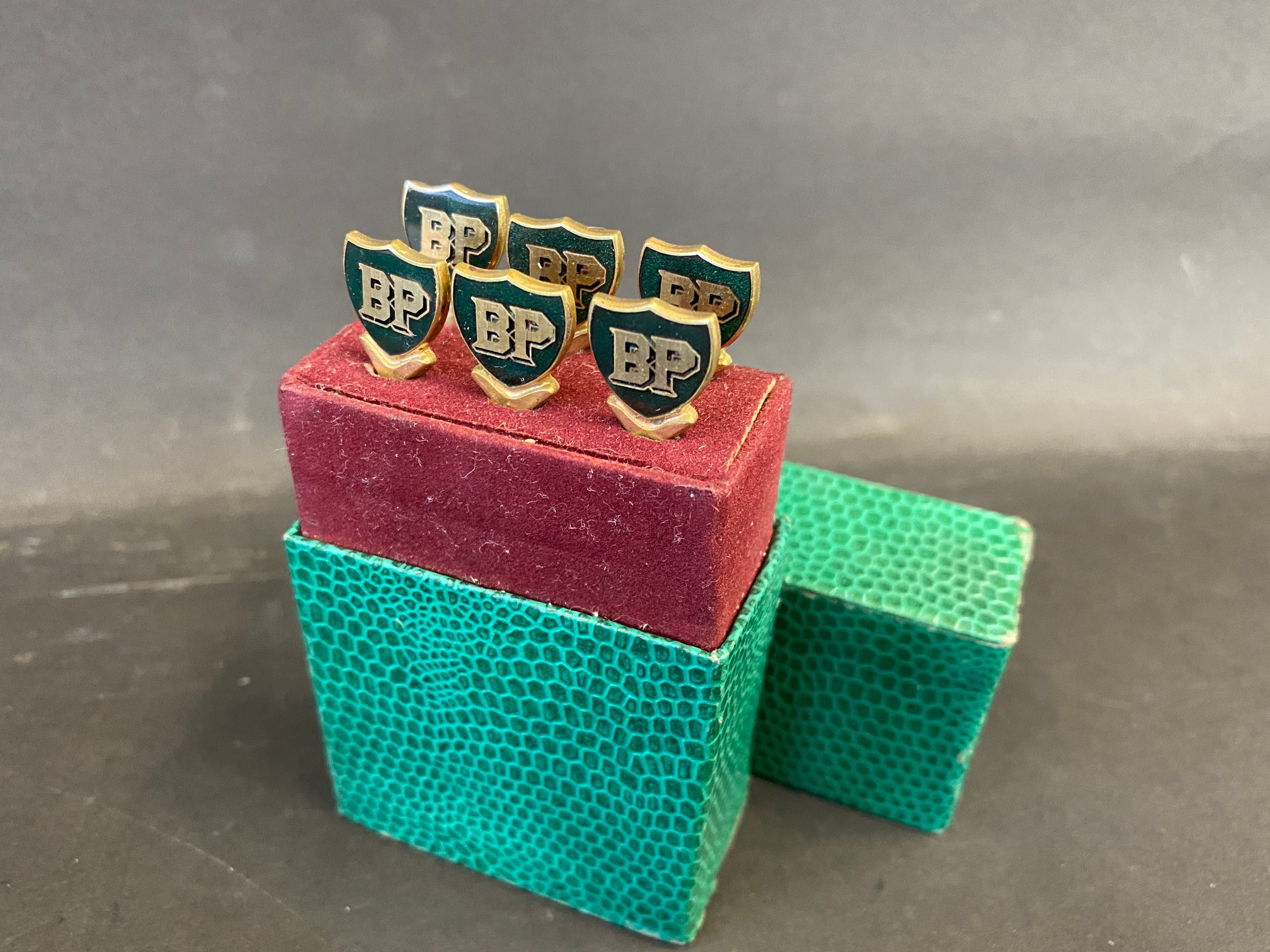 An unusual and complete boxed set of six B.P. cocktail sticks.