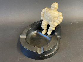 A Michelin bakelite ashtray surmounted by a seated Mr. Bibendum.