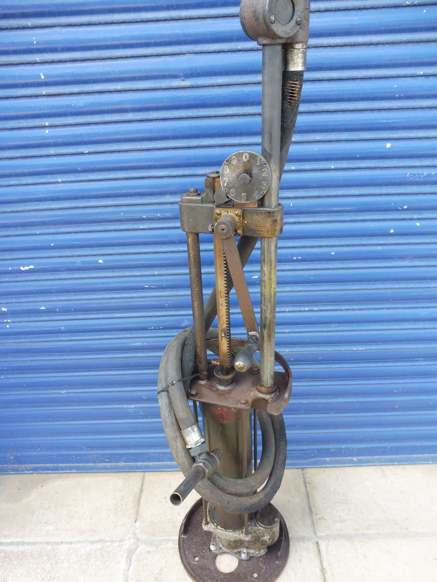 A Godwin hand-operated petrol pump with rubber hose and bronze nozzle. - Image 4 of 4