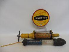 A Carburol UCL dispensing gun, a Bluecol tester and a Linklyfe tin.