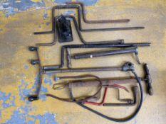 A selection of jack handles, stirrup pumps, a DWS jack handle etc.