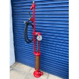 A Gilbert and Barker skeleton petrol pump, restored, with hose and nozzle.