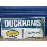 """A large Duckhams 20-50 Motor Oil tin sign, 78 1/2 x 39 1/2""""."""