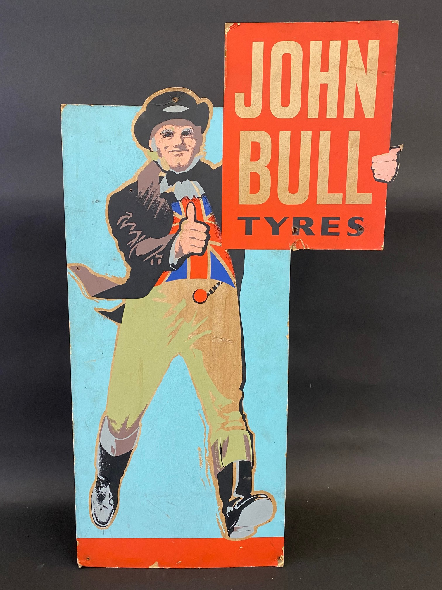 A John Bull Tyres pictorial die-cut easel showcard of a standing John Bull giving the thumbs up,