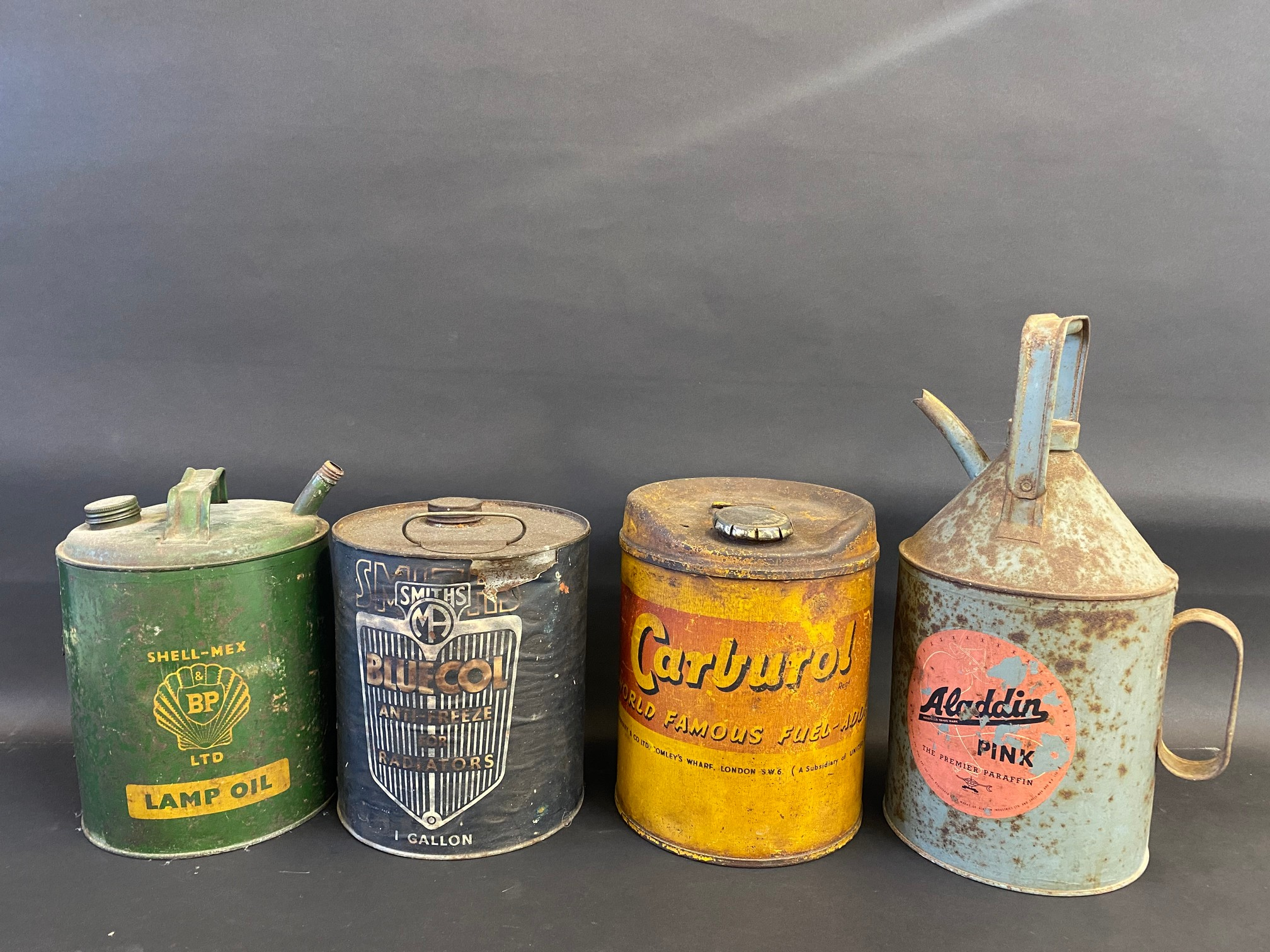 A Smiths Bluecol gallon can with paper label and three further cans.