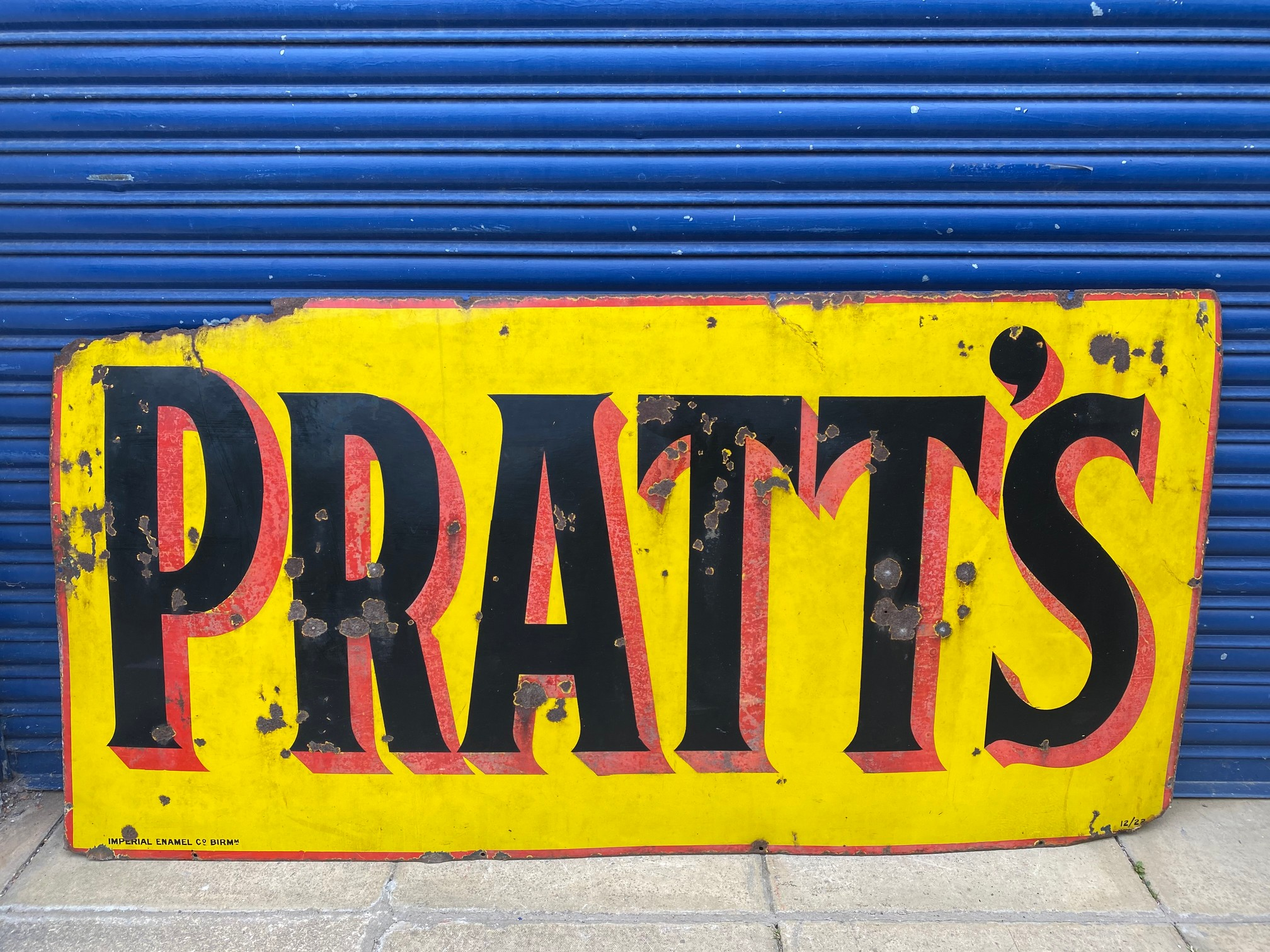 """A large Pratts rectangular enamel sign by Imperial Enamel Co, dated December 1922, 72 1/2 x 36""""."""