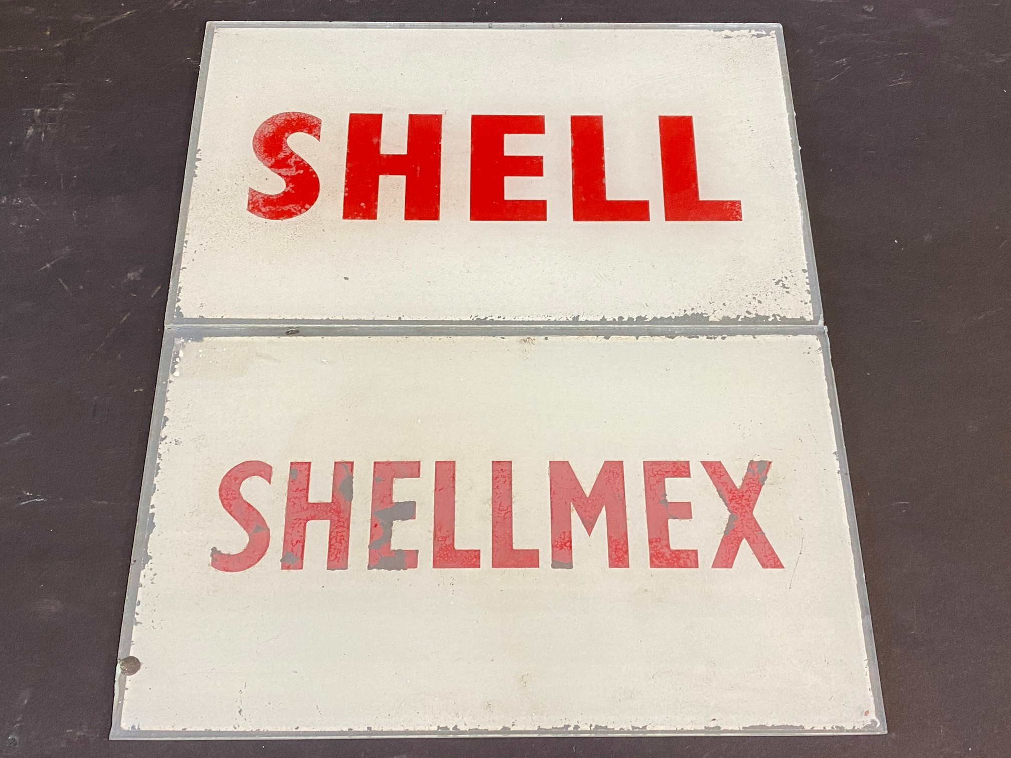 "A Shell glass petrol pump brand insert plus a second for Shellmex, both 8 1/2 x 5""."