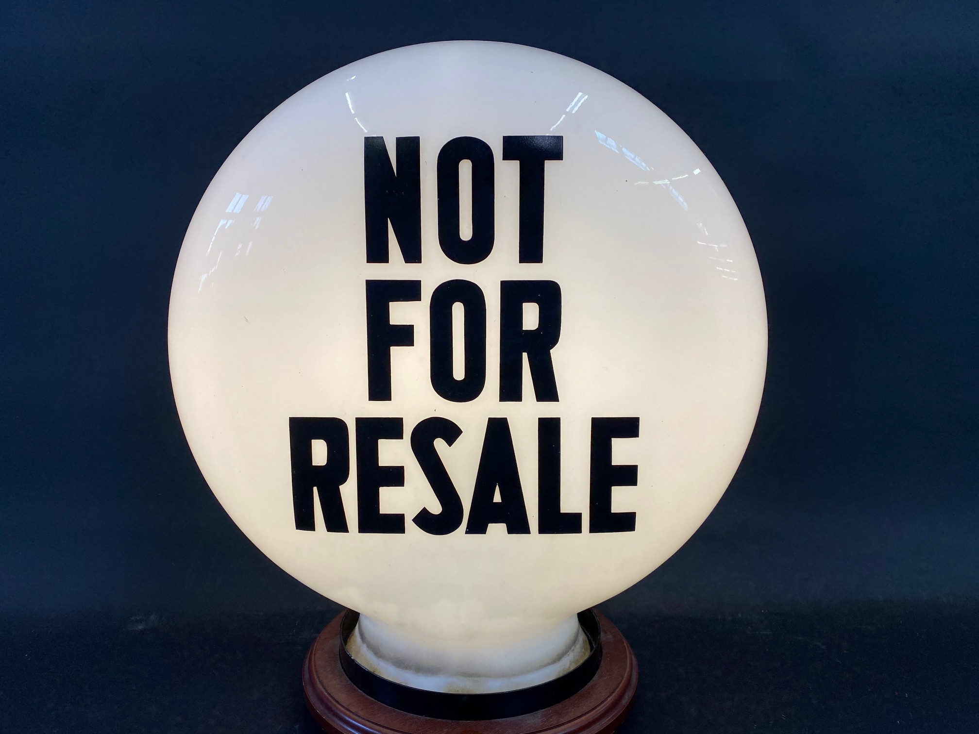 A 'Not For Resale' glass petrol pump globe by Hailware, in good condition, fully stamped 'Property