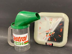 A Castrol one litre plastic measure and a Castrol TXT battery operated wall clock.