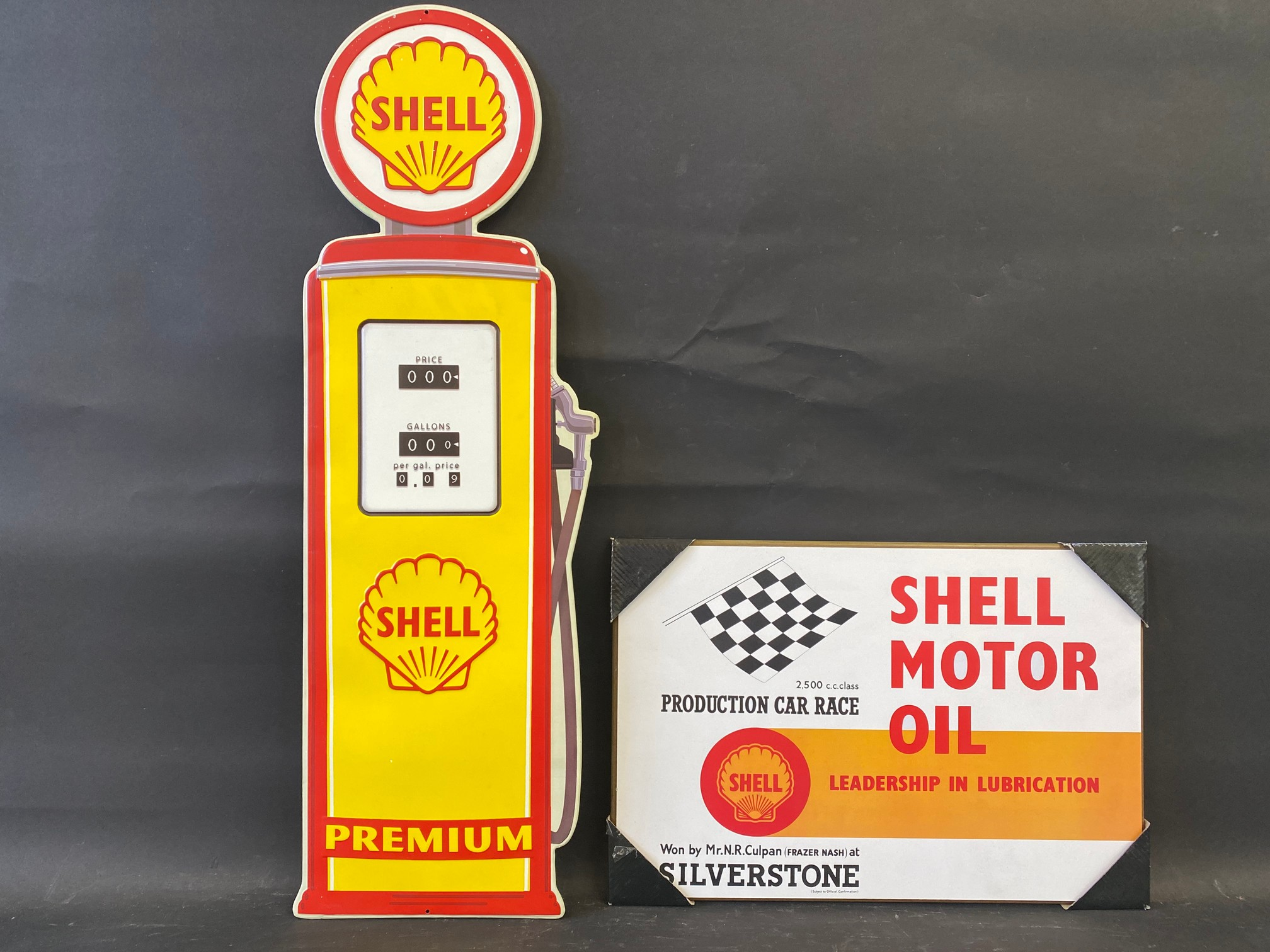 """A contemporary tin Shell sign in the shape of a petrol pump, 10 x 32"""" plus a Shell Motor Oil branded"""
