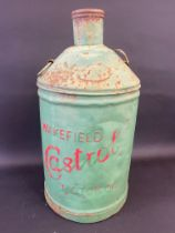 A Wakefield Castrol Motor Oil conical five gallon can with embossed lettering.