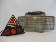 A Land Rover radiator grille plus a military issue trailer light cluster.
