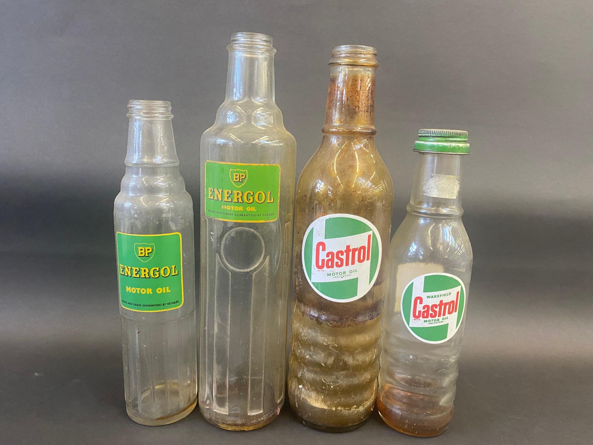Four Castrol and BP glass oil bottles.