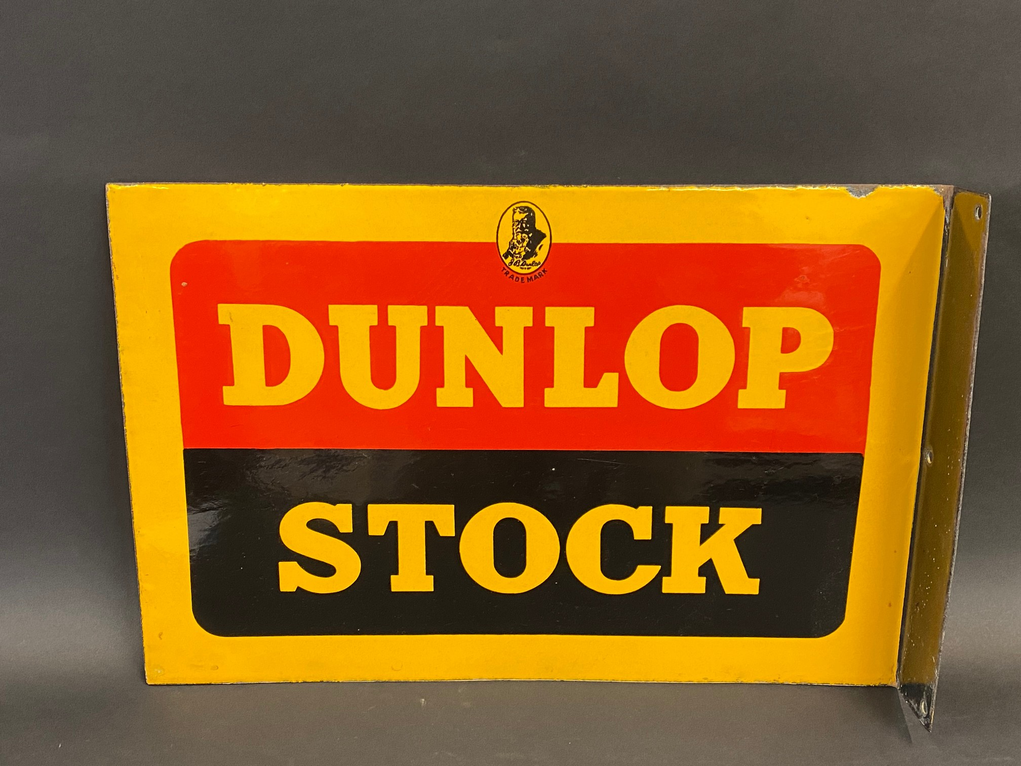 """A Dunlop Stock double sided enamel sign with hanging flange, in excellent condition, 18 x 12""""."""
