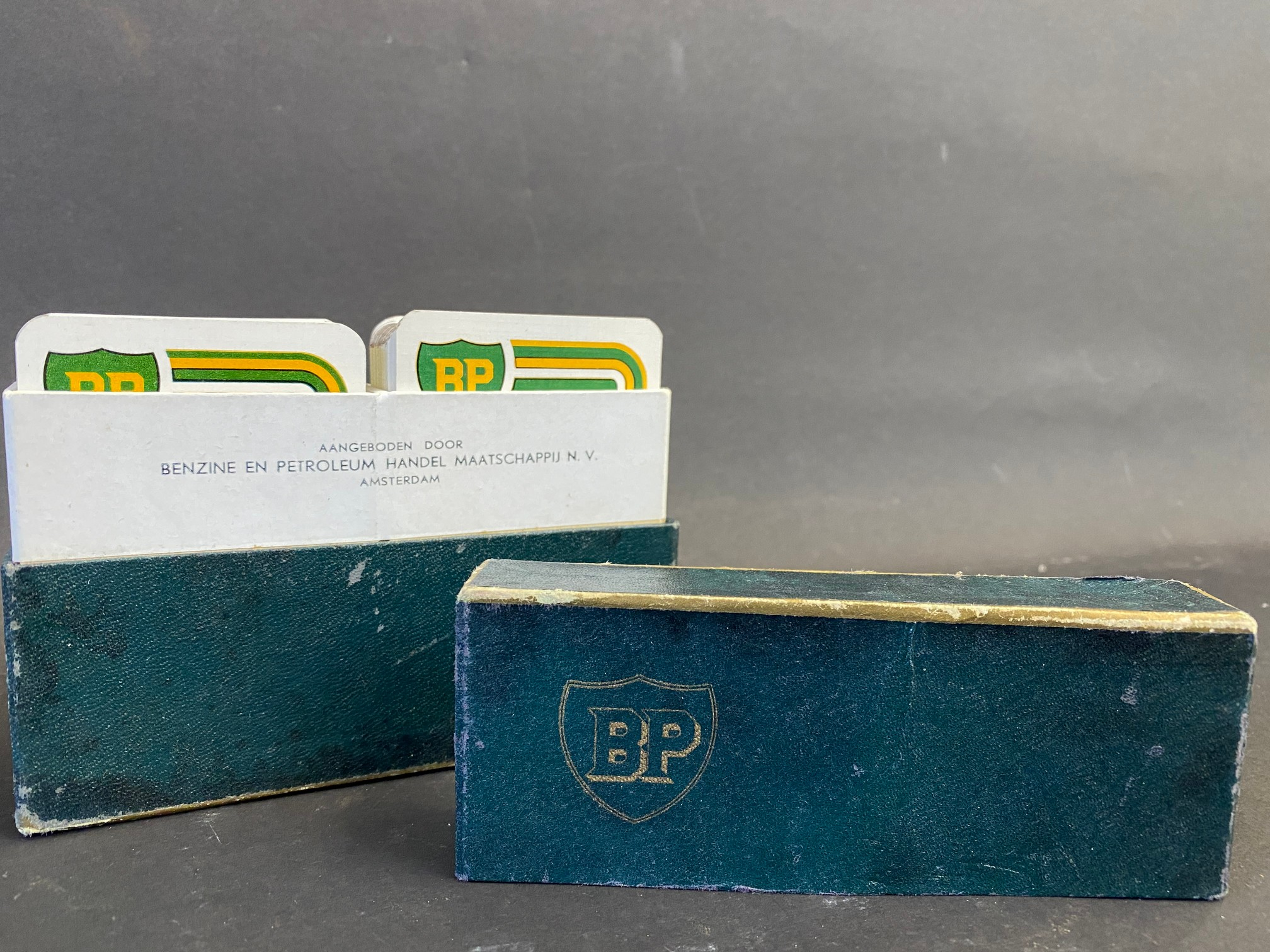 A near mint double set of BP playing cards.