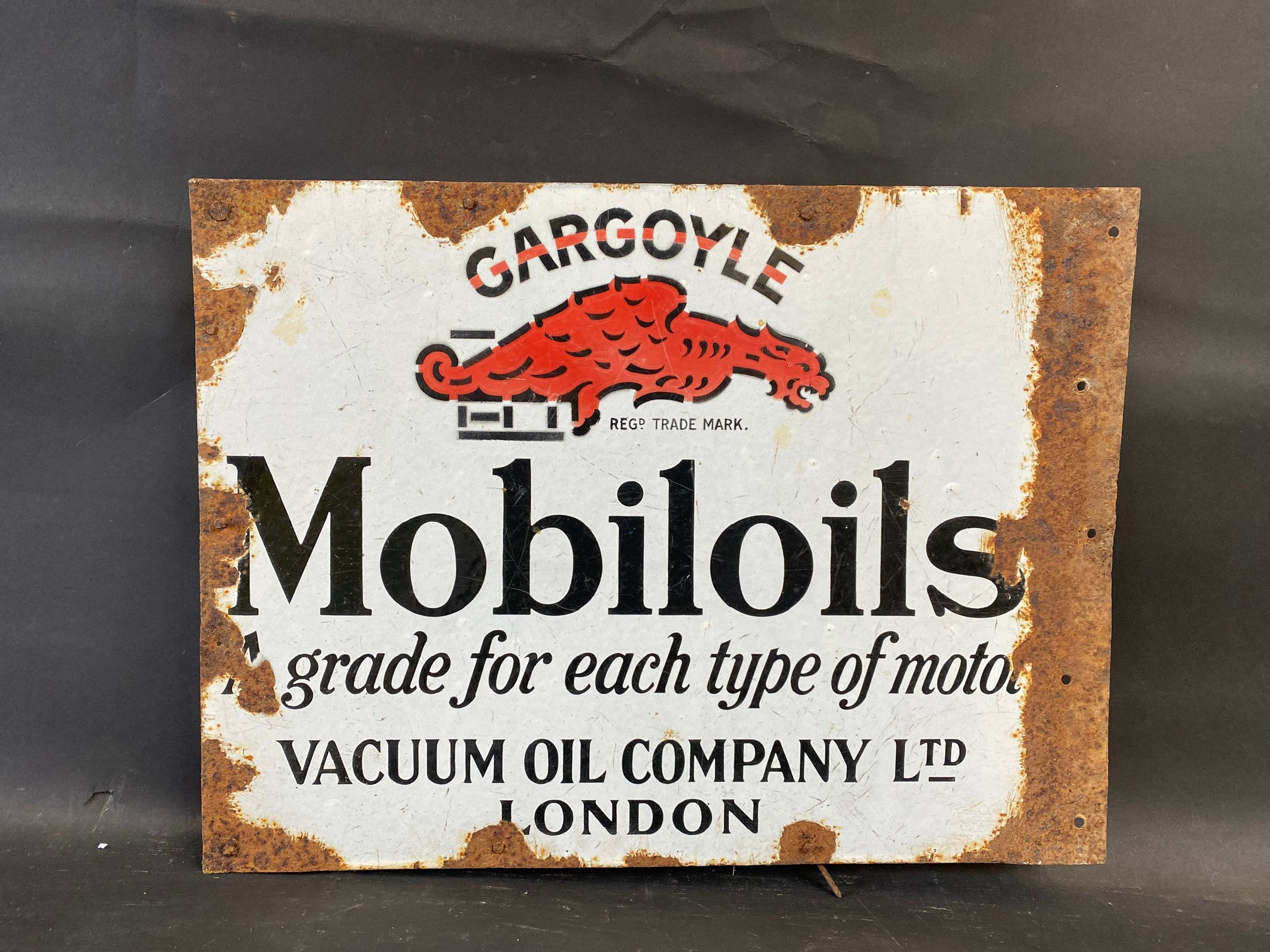 A Gargoyle Mobiloils 'a grade for each type of motor' double sided enamel sign with flattened