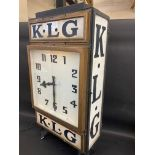 A rare and highly original K.L.G. garage advertising double sided clock with original dials and milk