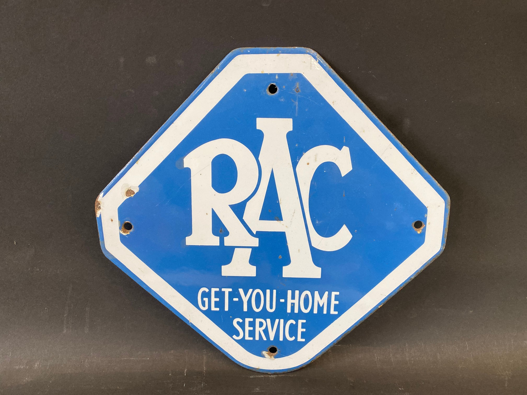 "An RAC Get-You-Home Service lozenge shaped enamel sign, 10 1/2 x 10""."