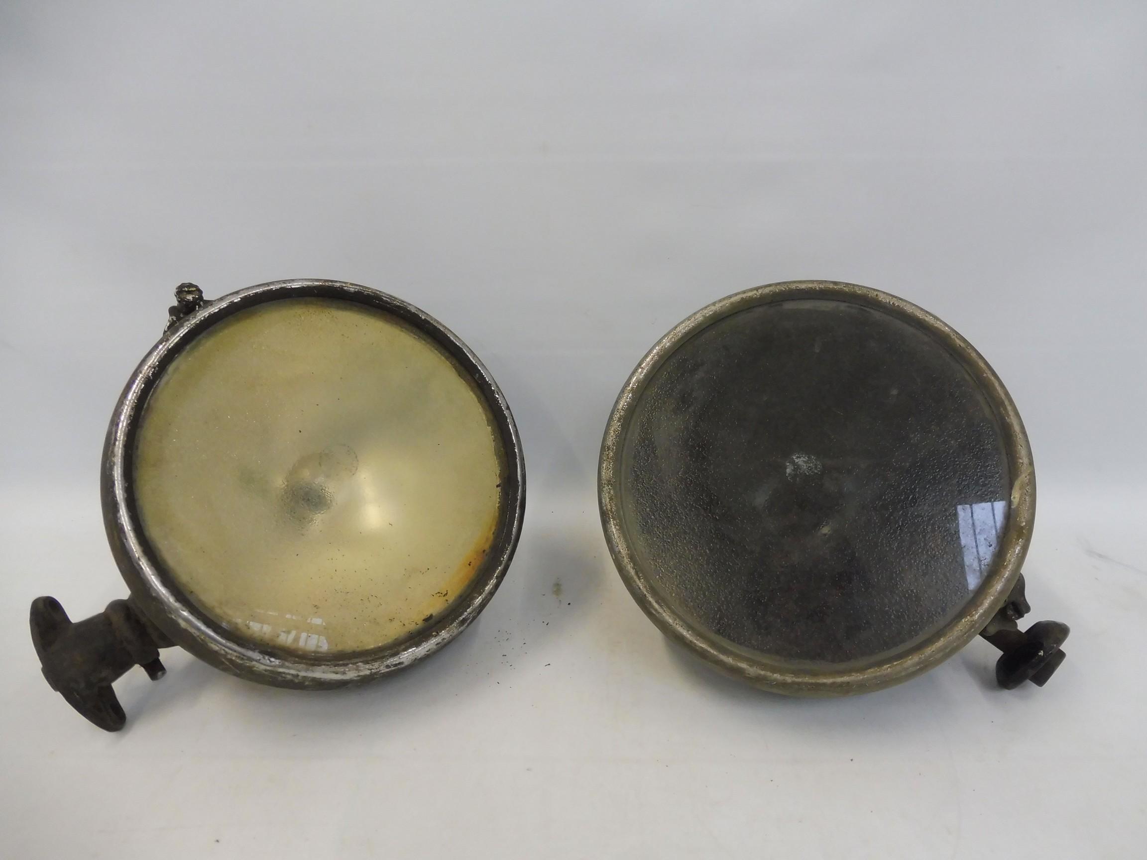 A pair of Lucas headlamps.