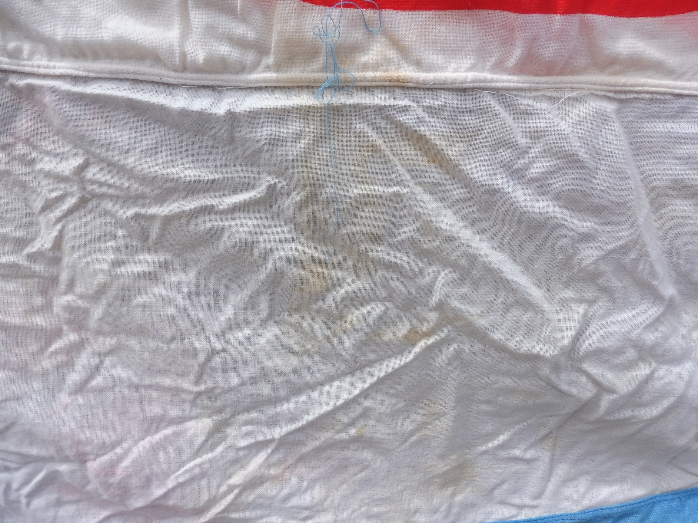 """A large garage forecourt pennant flag advertising TOTAL by Piggotts 11' 11"""" x 68"""". - Image 3 of 5"""