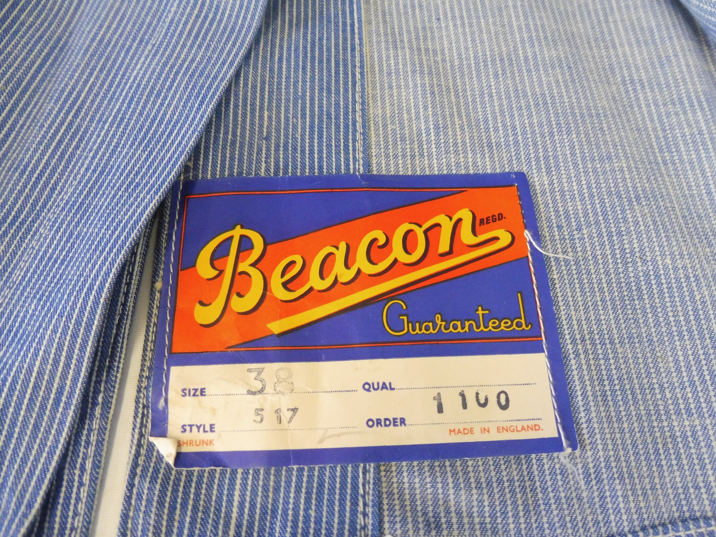 A new old stock overcoat with Esso branding, manufactured by Beacon Reg'd, size 38 (slightly - Image 5 of 6