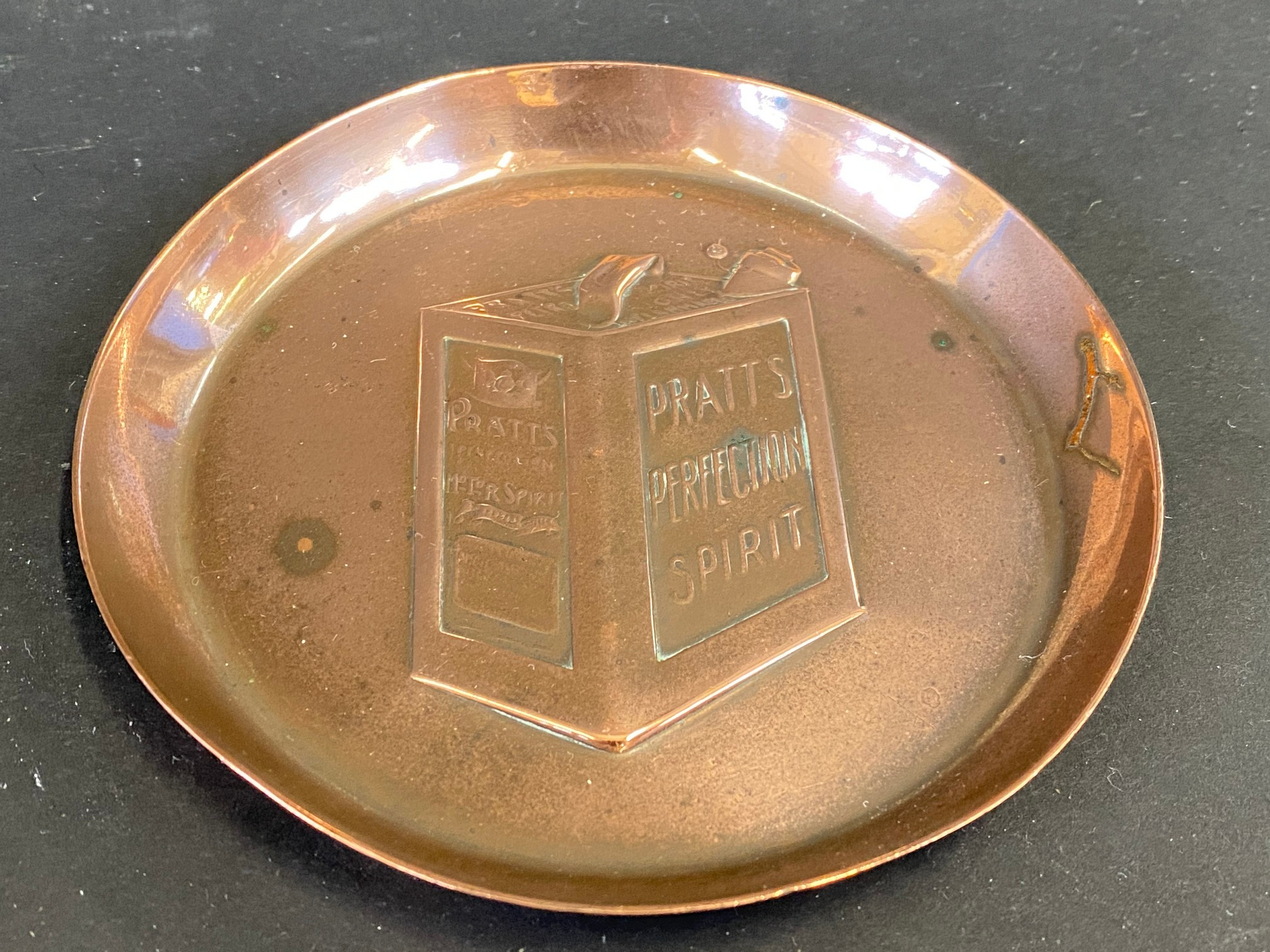 A copper ashtray advertising Pratt's Perfection Spirit, stamped J.S&S.