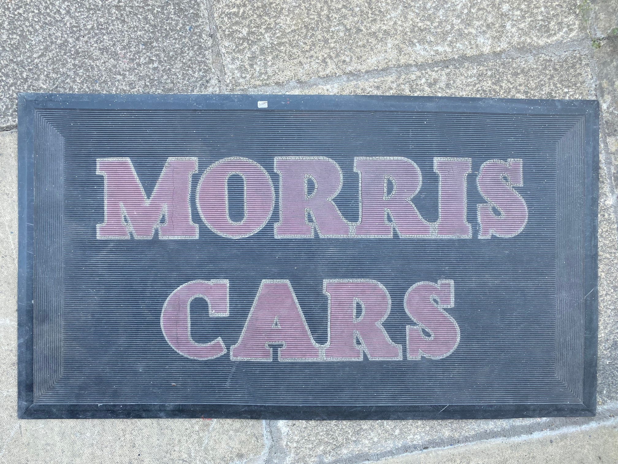A Morris Cars rubber garage showroom mat.