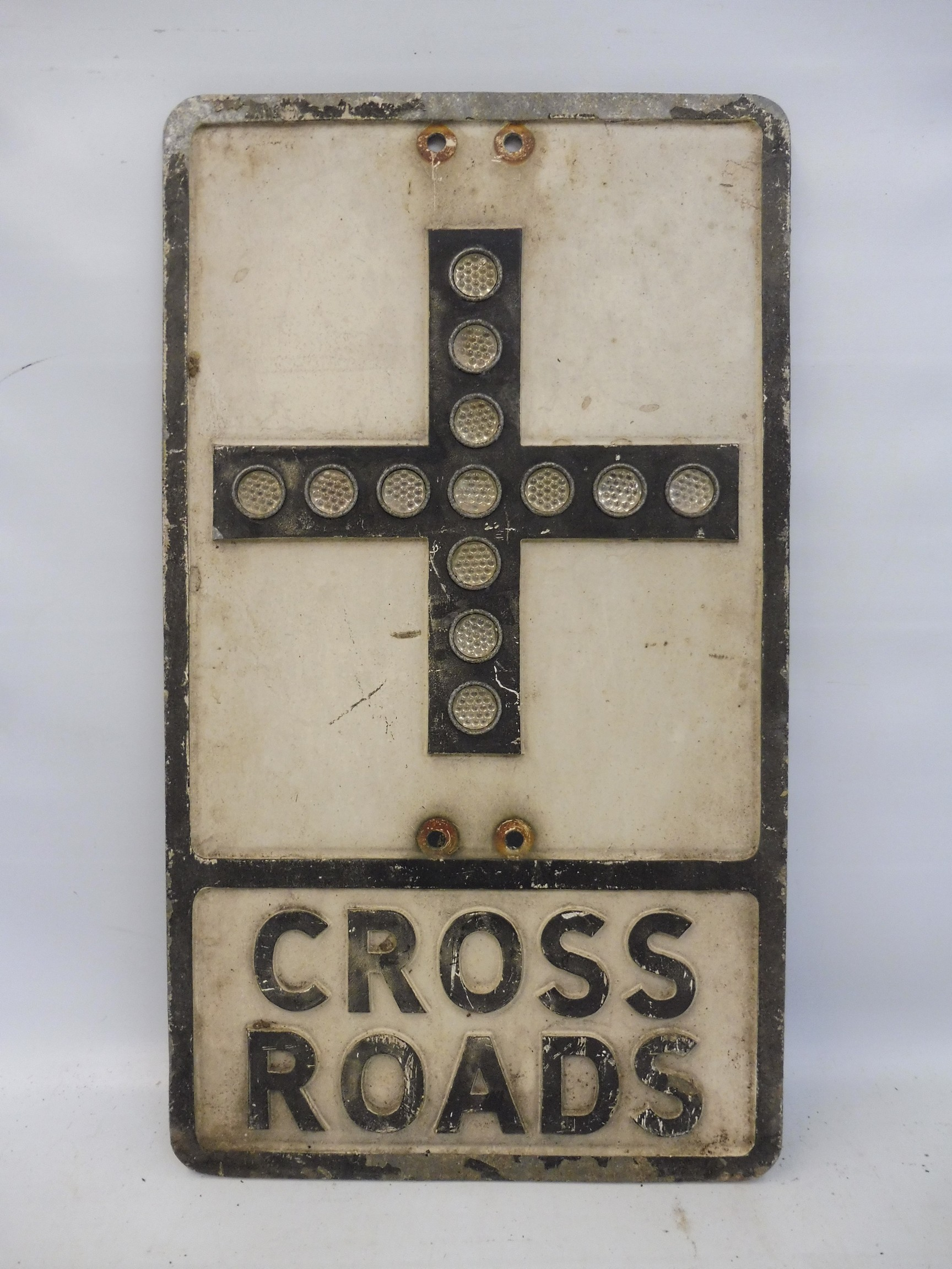 """Cross Roads - an aluminium road sign with glass reflective discs, 12 x 21""""."""