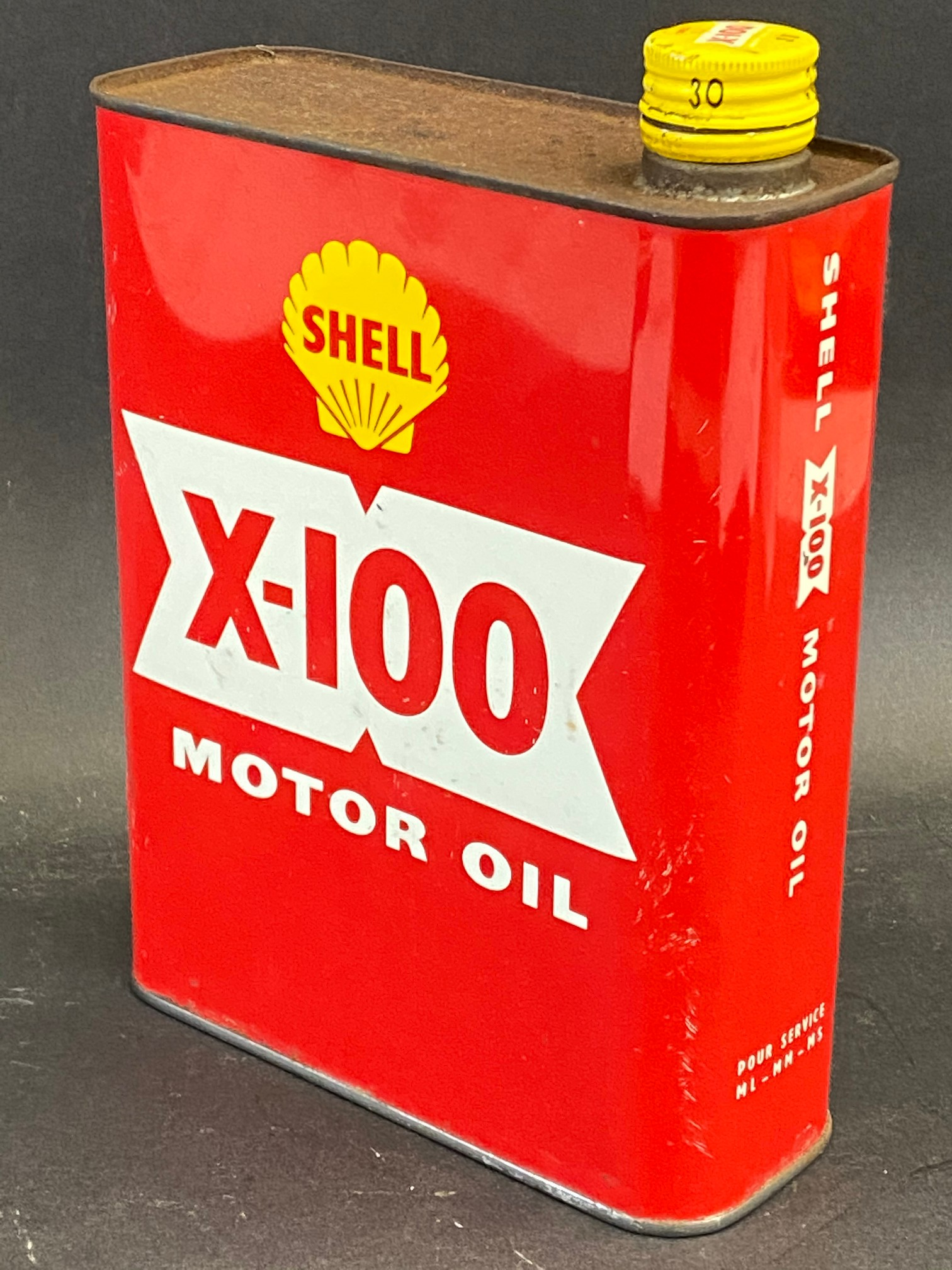 A red Shell X-100 Motor Oil can.