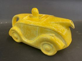 An Art Deco Sadler teapot in the form of a streamlined motor car, yellow version.