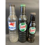 A Mobiloil quart oil bottle, a Castrol Motor Oil quart bottle and a pint Wakefield Castrol bottle.