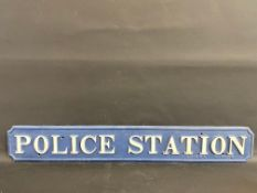 """A rare cast iron Police Station sign, marked Briggs Barrow, 48 x 7 1/2""""."""