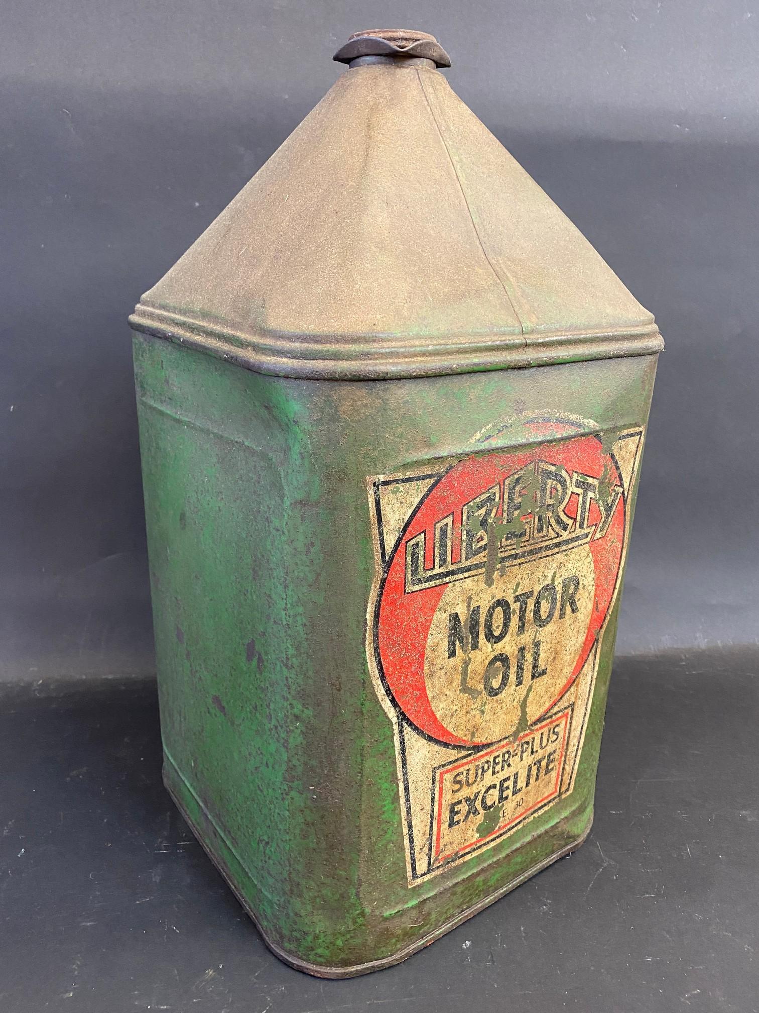 A Liberty Motor Oil square five gallon pyramid can.