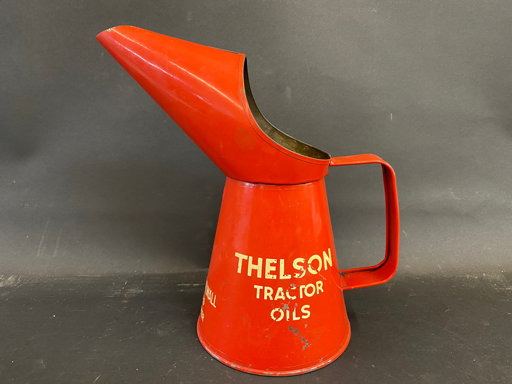 A Thelson Tractor Oils quart measure, in good condition.