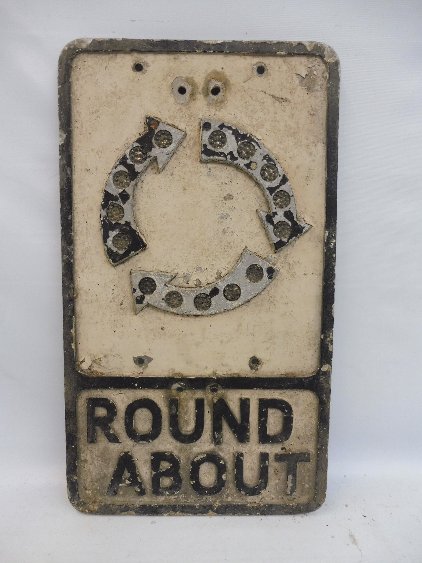 """An aluminum road sign - Round About, with glass reflective discs, 12 x 21""""."""