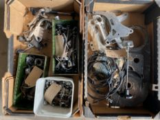 An autojumbler's lot in two boxes including parts for clutch, brake, choke, air and decompressor