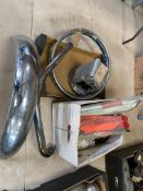 Two boxes of spares including a Velocette Venom exhaust down pipe, Triumph Bonneville Jubilee S/S