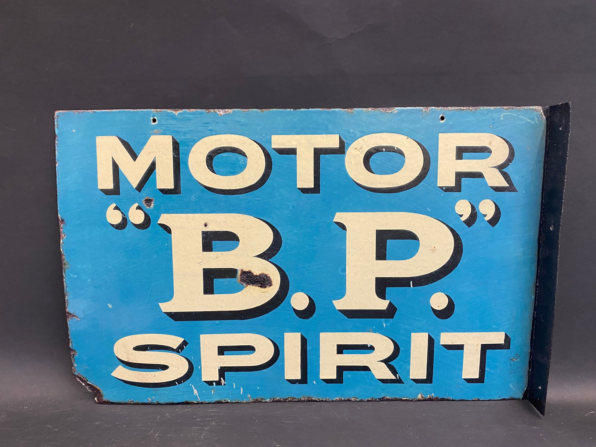 An early and rarely seen B.P. Motor Spirit double sided enamel sign with hanging flange (re-