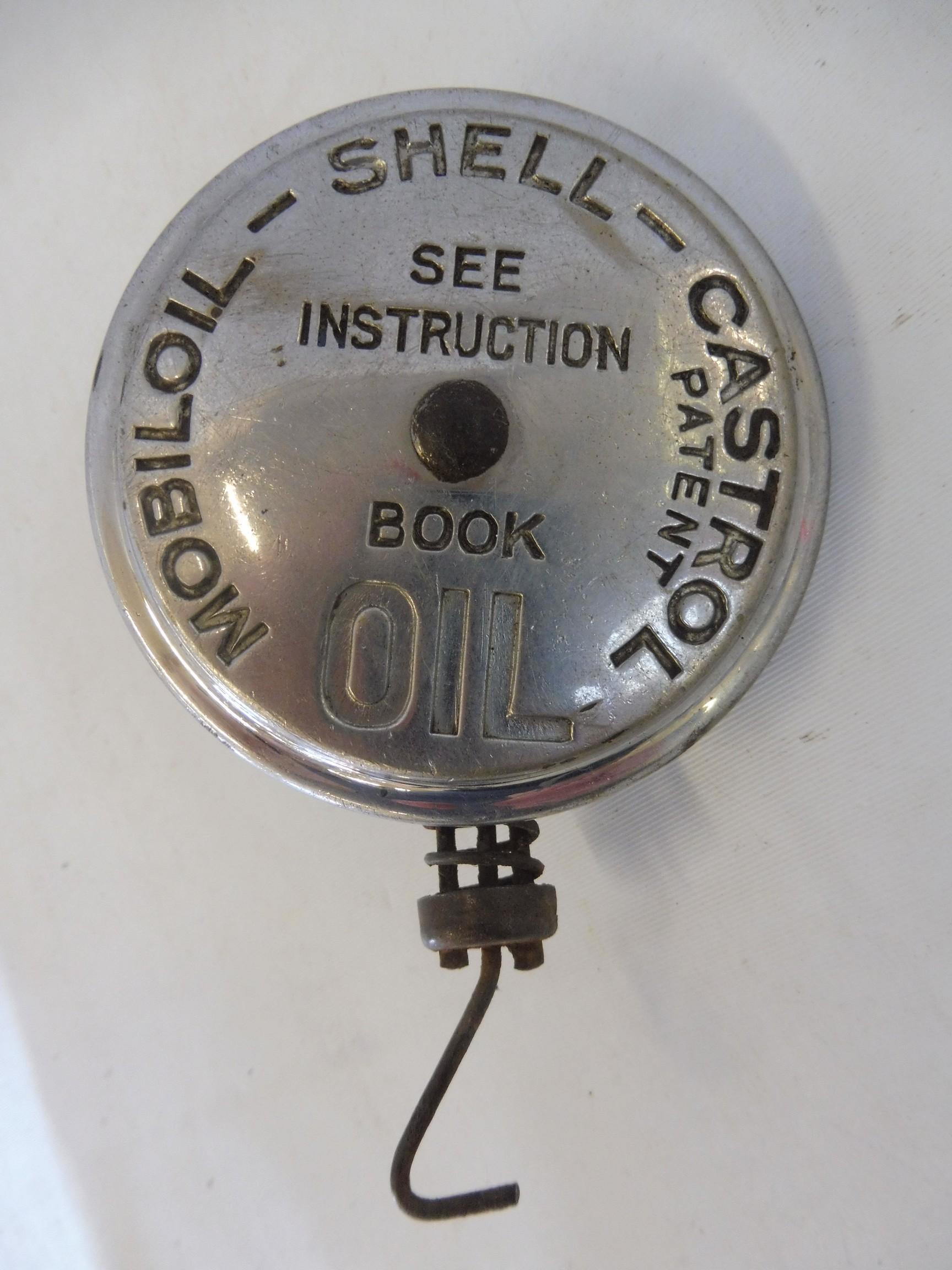A Mobiloil-Shell-Castrol oil filter cap.