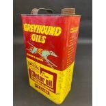 A Greyhound Oils gallon can.