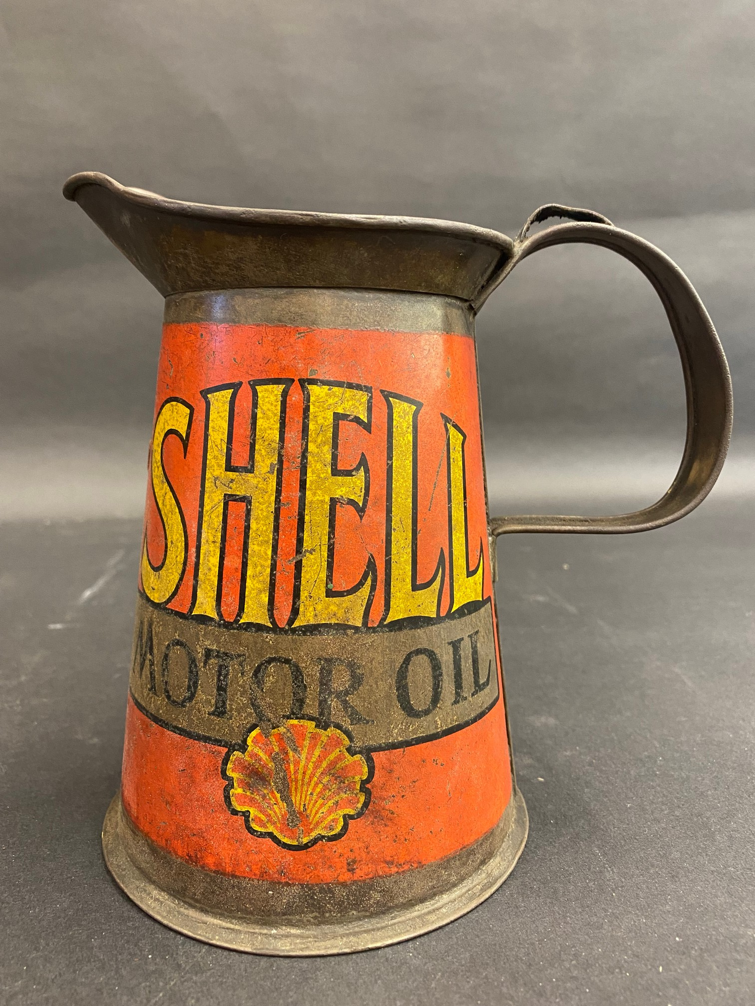 A Shell Motor Oil quart measure, early wide neck version, dated 1929.