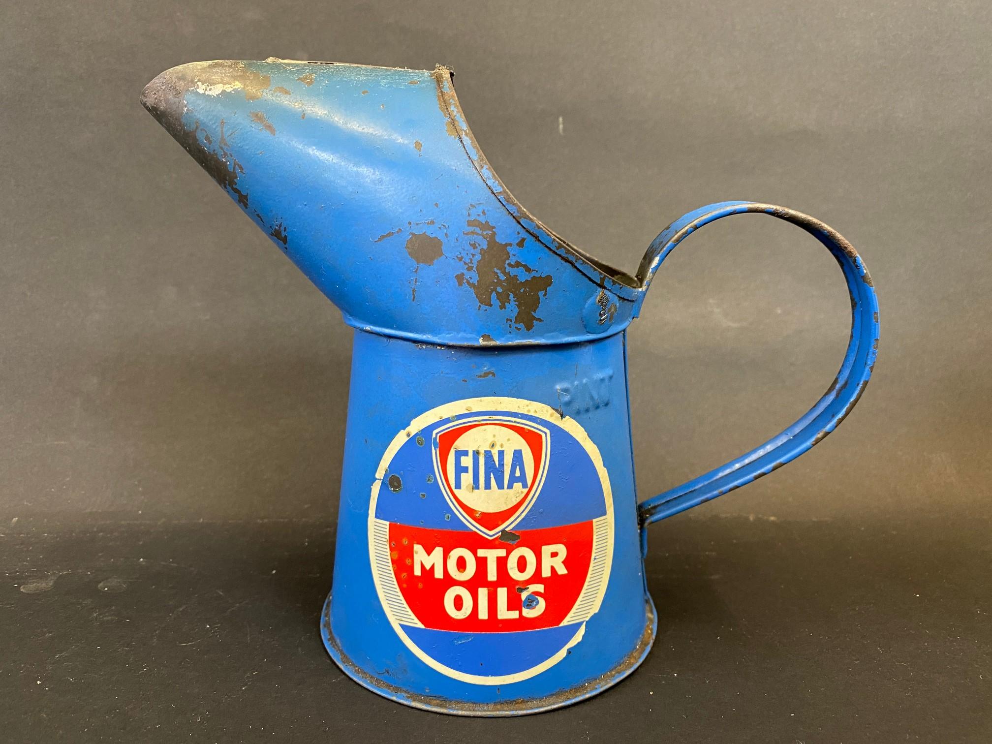 A Fina Motor Oils pint measure.