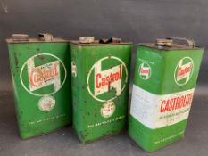 Three Castrol gallon cans.