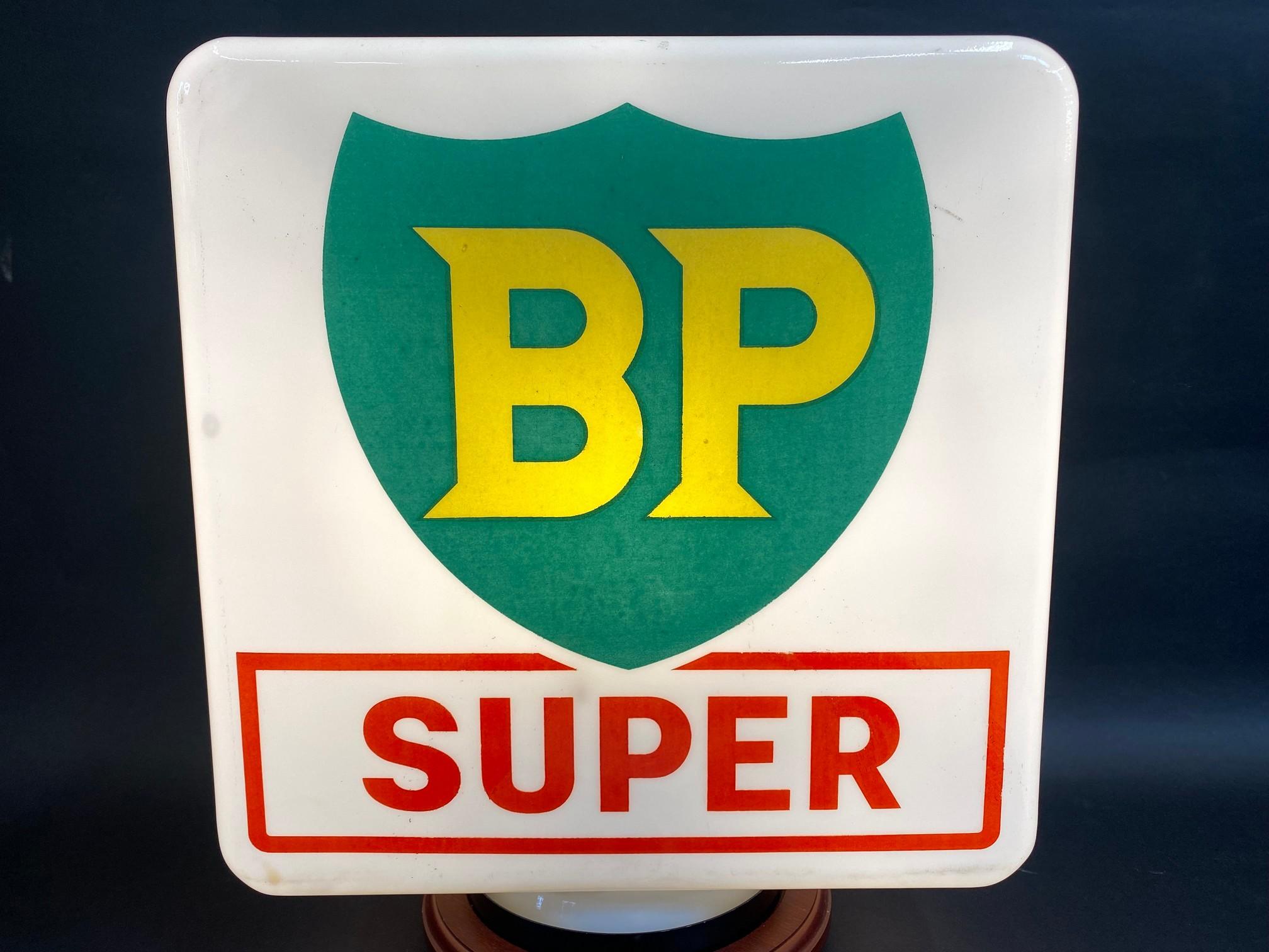 A BP Super glass pump globe by Webbs, bright colour, slight damage to one corner.