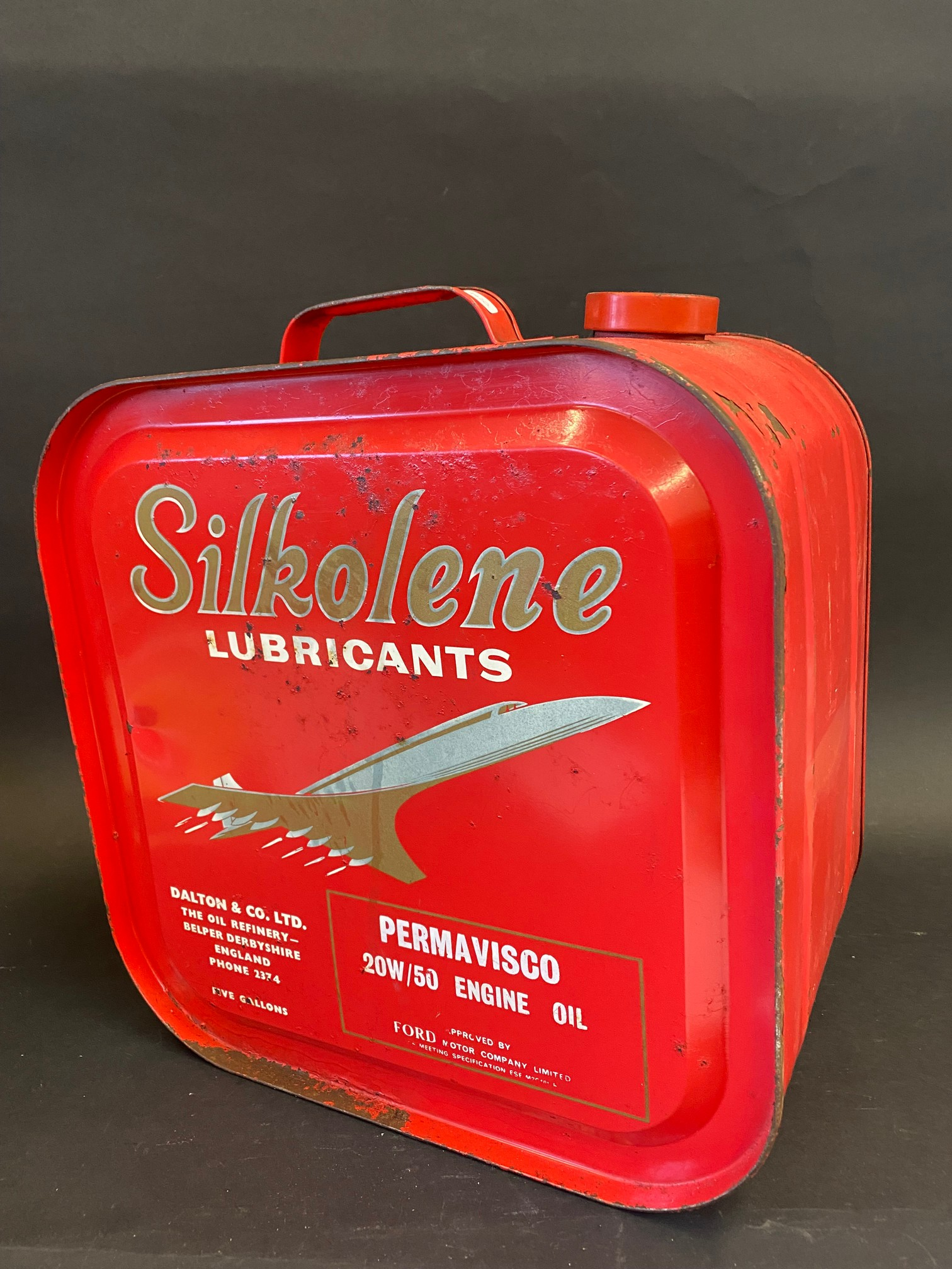 A Silkolene Lubricants five gallon drum with an image of Concorde to either side.