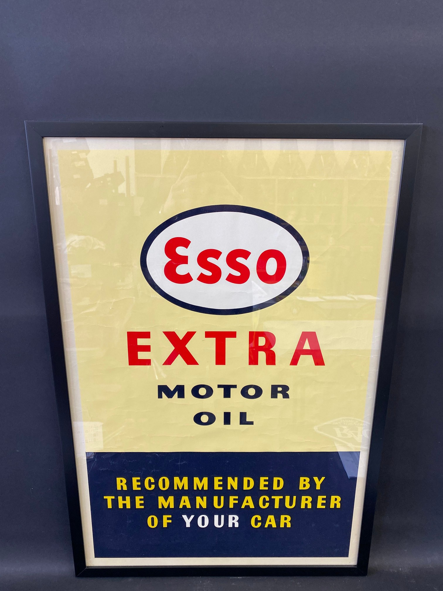"""An original Esso Extra Motor Oil advertisement, framed and glazed, 21 1/2 x 31 1/2""""."""