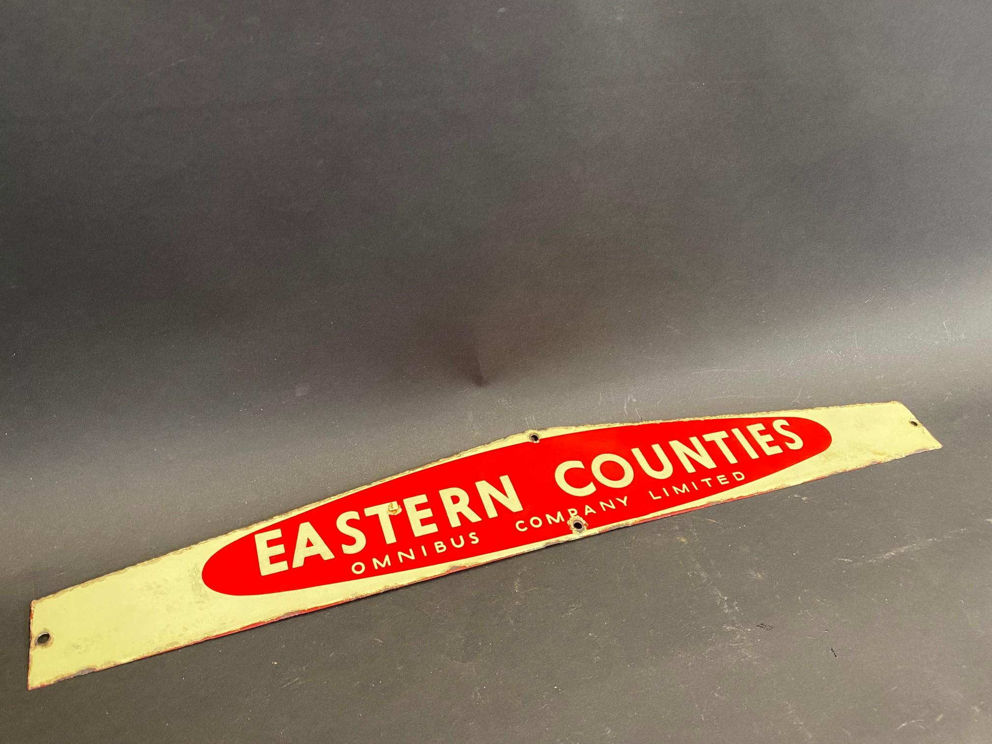 "An Eastern Counties enamel notice board header sign, 22 1/2 x 3 1/4""."